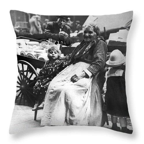 1890 Throw Pillow featuring the photograph A Family And Their Push Cart by Underwood Archives