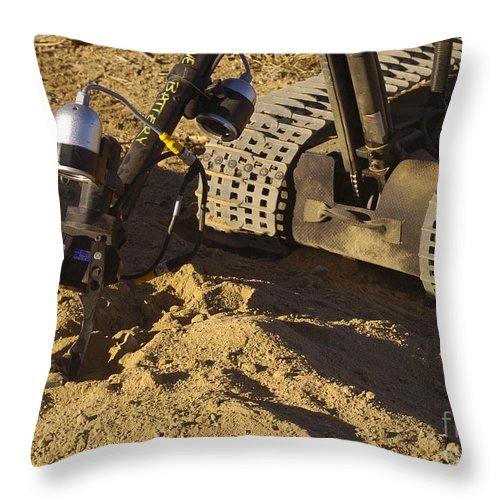 Tracked Vehicles Throw Pillow featuring the photograph A Foster-miller Talon Mk II Ordnance by Stocktrek Images