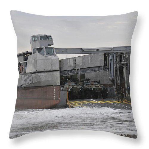 Exercise Bold Alligator Throw Pillow featuring the photograph A French Landing Craft Comes Ashore by Stocktrek Images