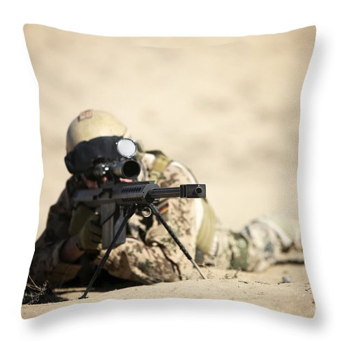 Army Throw Pillow featuring the photograph A German Soldier Sights In A Barrett by Terry Moore