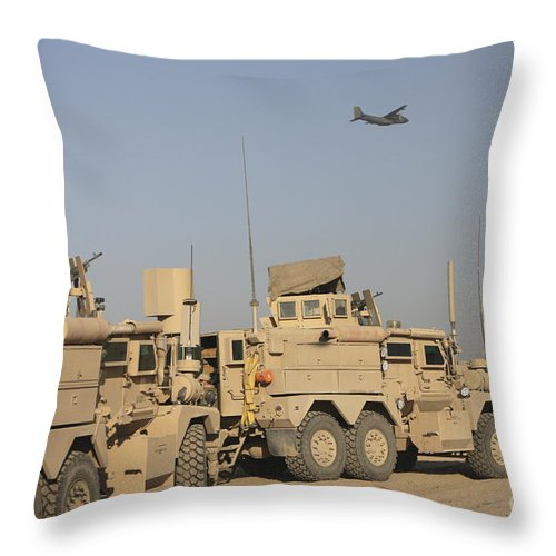 Kunduz Throw Pillow featuring the photograph A German Transall C-160 Flies Over Two by Terry Moore