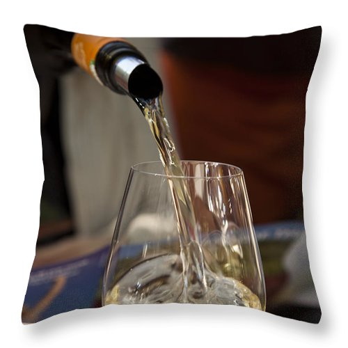One Person Throw Pillow featuring the photograph A Glass Of White Wine Being Poured by Taylor S. Kennedy