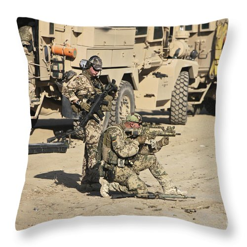Cougar Throw Pillow featuring the photograph A Ksk Kommando Spezialkrafte Fires by Terry Moore