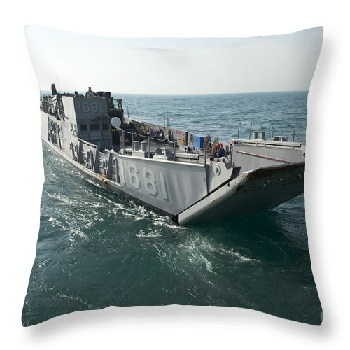 Warship Throw Pillow featuring the photograph A Landing Craft Utility Transits by Stocktrek Images