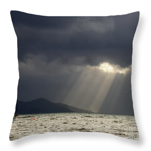 Seascape Throw Pillow featuring the photograph A Light In The Storm by Lainie Wrightson