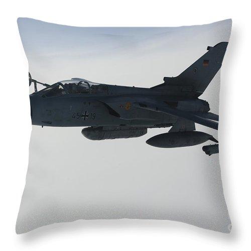 Germany Throw Pillow featuring the photograph A Luftwaffe Tornado Ids Refueling by Gert Kromhout