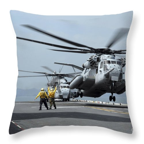 Japan Throw Pillow featuring the photograph A Marine Mh-53 Helicopter Takes by Stocktrek Images