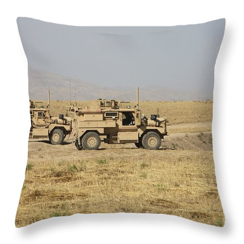 Arid Climate Throw Pillow featuring the photograph A Pair Of U.s. Army Cougar Mrap by Terry Moore