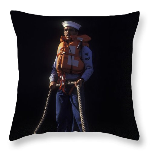 Sailors Throw Pillow featuring the photograph A Petty Officer Secures Rope Tied by Michael Wood