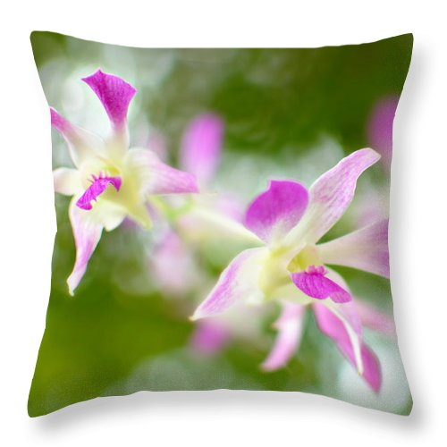 Orchid Throw Pillow featuring the photograph A Pillow Of Winds by Floyd Menezes