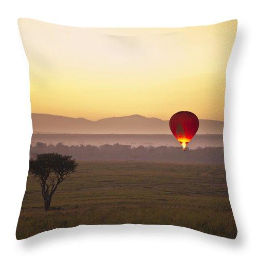 Adventure Throw Pillow featuring the photograph A Red Hot Air Balloon Takes Flight by David DuChemin
