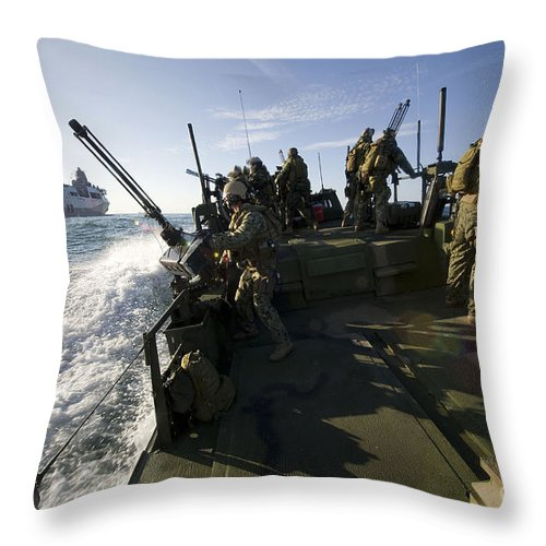 Exercise Bold Alligator Throw Pillow featuring the photograph A Riverine Squadron Conducts Security by Stocktrek Images