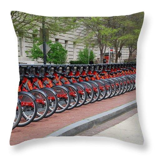 Washington D C Throw Pillow featuring the digital art A Row Of Red Bikes by Eva Kaufman
