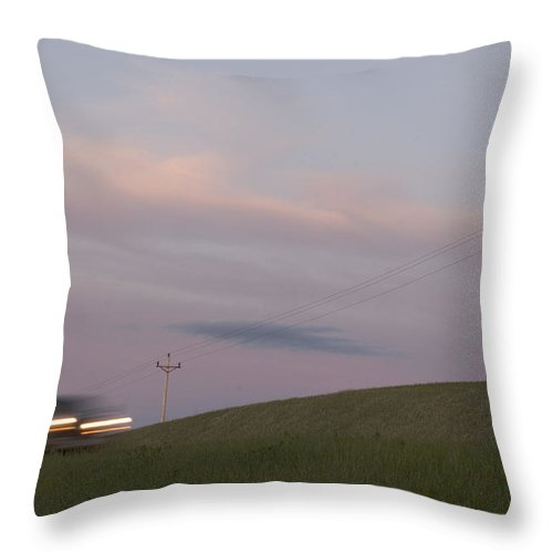 Outdoors Throw Pillow featuring the photograph A Row Of Telephone Poles Near A Road by Phil Schermeister
