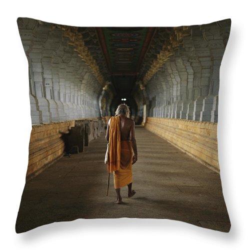 Hindu Clergy Throw Pillow featuring the photograph A Sadu Walks Through Rameswaram Temples by Justin Guariglia