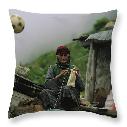Peoples Throw Pillow featuring the photograph A Soccer Ball Flies Over The Head by Randy Olson
