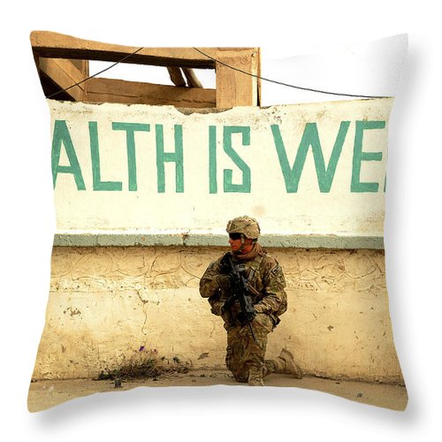 Village Throw Pillow featuring the photograph A Soldier Talks To An Afghan Boy by Stocktrek Images