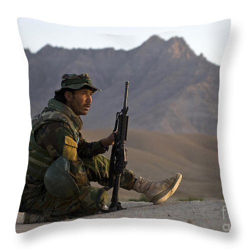 Afghan National Army Throw Pillow featuring the photograph A Soldier With The Afghan National Army by Stocktrek Images