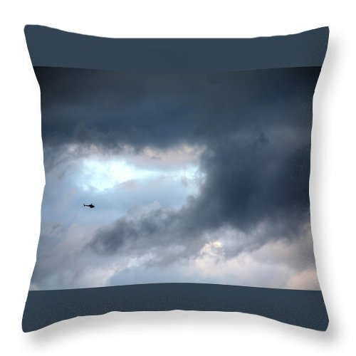 Light Throw Pillow featuring the photograph A Speck In The Sky by Terry Wallace