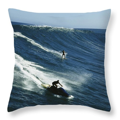A Surfer And Jet-skier Off The North Shore Of Maui Island. Throw Pillow featuring the photograph A Surfer And Jet-skier Off The North by Patrick Mcfeeley