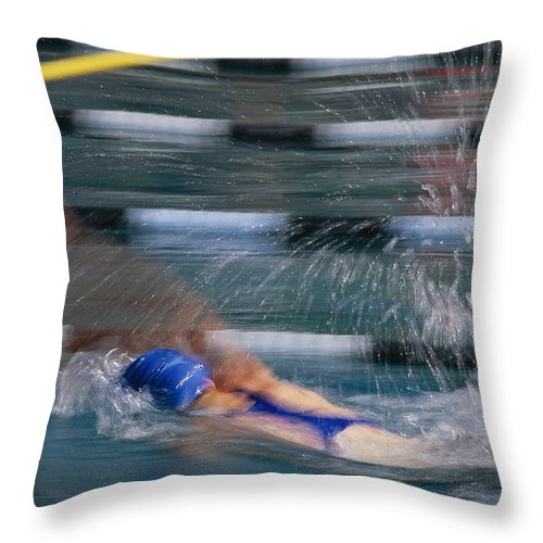 North America Throw Pillow featuring the photograph A Swimmer Races Through The Water by Michael S. Lewis