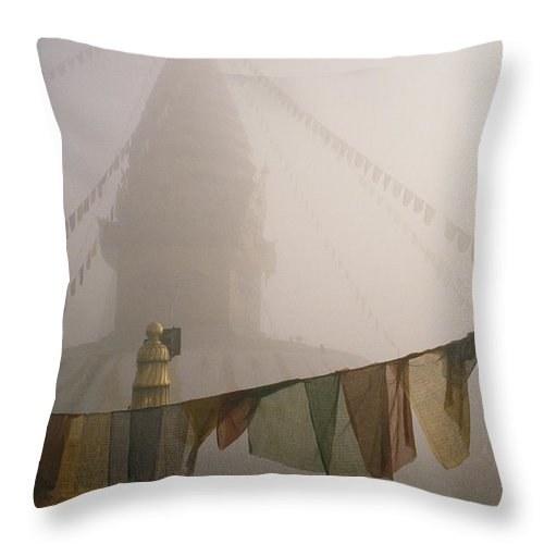 Religion Throw Pillow featuring the photograph A Temple And Prayer Flags Shrouded by David Edwards