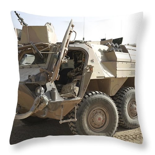 Isaf Throw Pillow featuring the photograph A Tpz Fuchs Armored Personnel Carrier by Terry Moore
