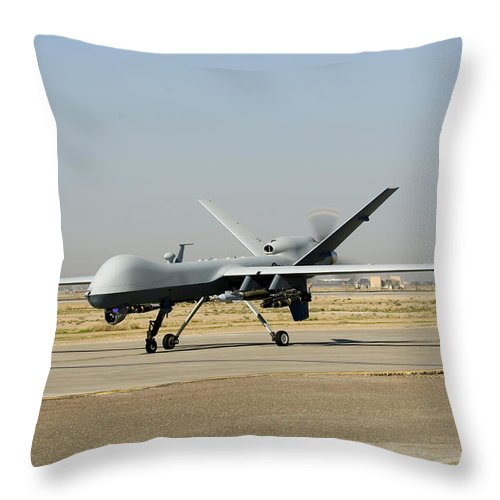 Military Throw Pillow featuring the photograph A U.s. Air Force Mq-9 Reaper Unmanned by Stocktrek Images