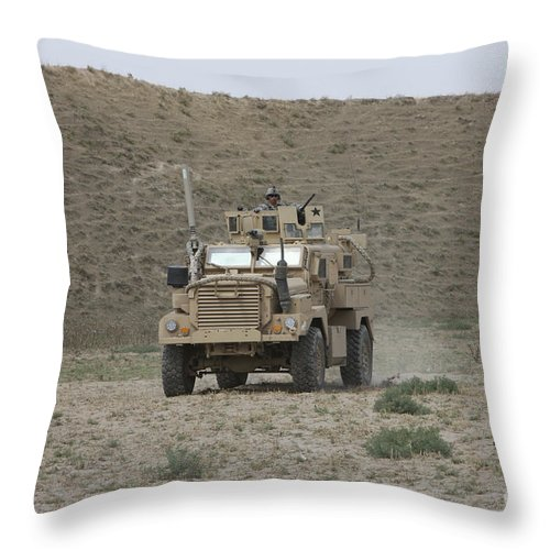 Mrap Throw Pillow featuring the photograph A U.s. Army Cougar Patrols A Wadi by Terry Moore