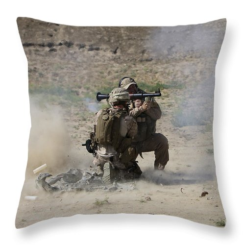 Soldier Throw Pillow featuring the photograph A U.s. Contractor Fires by Terry Moore