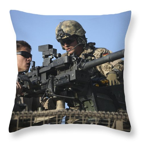 Afghanistan Throw Pillow featuring the photograph A U.s. Marine Fires A Gmg Automatic by Terry Moore