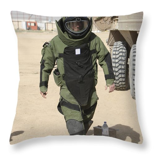 Soldier Throw Pillow featuring the photograph A U.s. Marine Gets Suited by Terry Moore