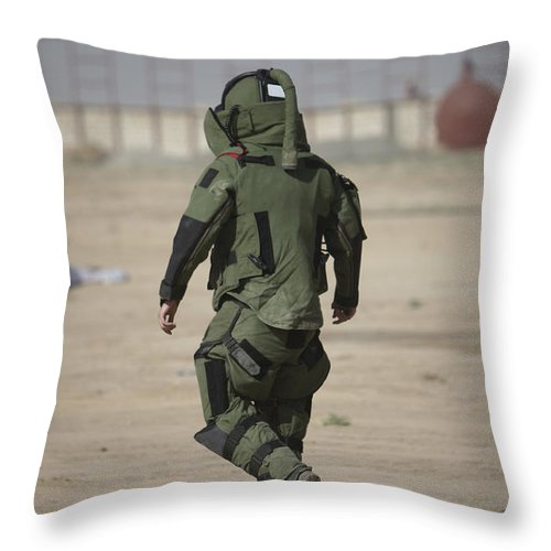 Kunduz Throw Pillow featuring the photograph A U.s. Marine Tries Running In A Bomb by Terry Moore