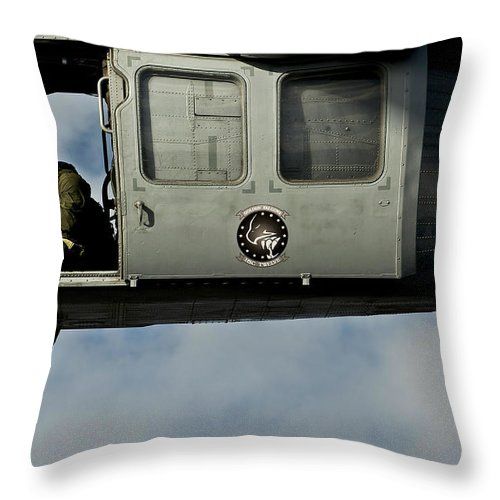 Uss Carl Vinson Throw Pillow featuring the photograph A U.s. Navy Naval Air Crewman Guides by Stocktrek Images