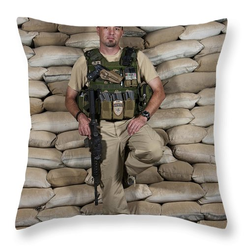 Operation Enduring Freedom Throw Pillow featuring the photograph A U.s. Police Officer Contractor Leans by Terry Moore