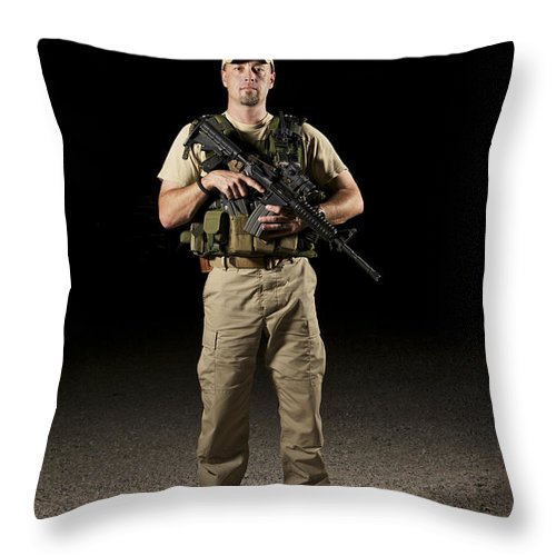 Equipment Throw Pillow featuring the photograph A U.s. Police Officer Contractor by Terry Moore
