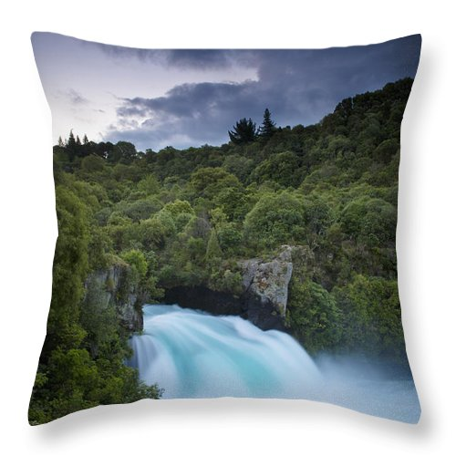 Cloud Throw Pillow featuring the photograph A Waterfall Surrounded By A Forested by David DuChemin