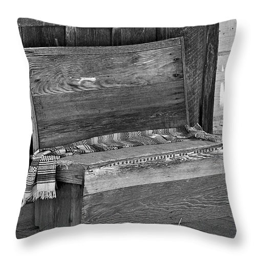Bench Throw Pillow featuring the photograph A Weathered Bench Black And White by Phyllis Denton