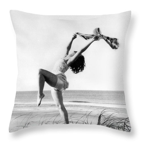 16-20 Years Throw Pillow featuring the photograph A Woman Dancing On The Shore by Underwood Archives