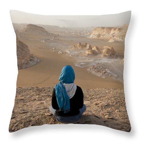 25-30 Years Throw Pillow featuring the photograph A Woman Sits Quietly On A Cliff Looking by Taylor S. Kennedy