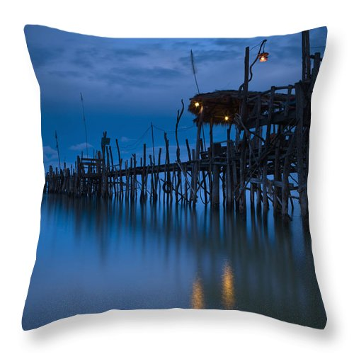 Color Image Throw Pillow featuring the photograph A Wooden Pier With Lights On It At by David DuChemin