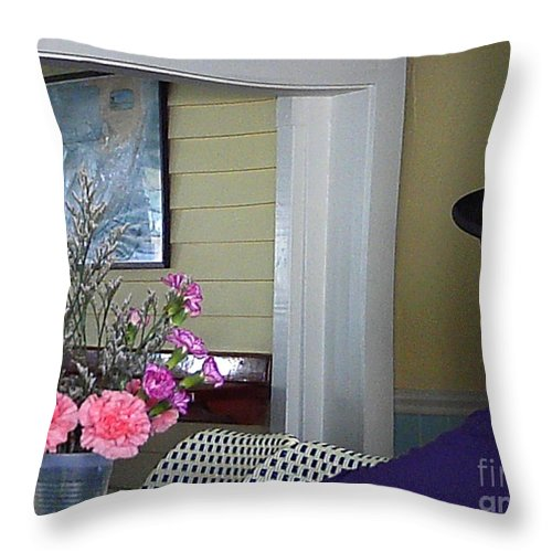 Flower Throw Pillow featuring the photograph Admiring The Southernmost Flowers by Jan Prewett