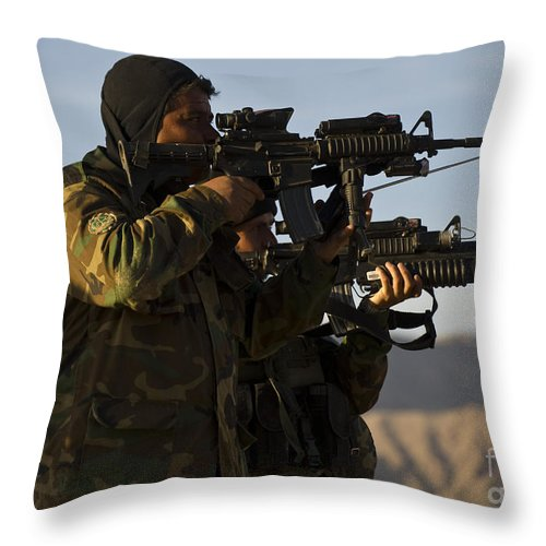 Military Throw Pillow featuring the photograph Afghan National Army Commandos Aim by Stocktrek Images