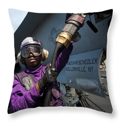 Warship Throw Pillow featuring the photograph Airman Fuels An Fa-18c Hornet by Stocktrek Images
