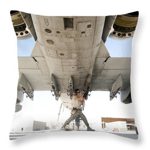 Kandahar Throw Pillow featuring the photograph Airman Performs An Inspection by Stocktrek Images