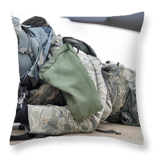 Military Throw Pillow featuring the photograph Airman Provides Security At Whiteman by Stocktrek Images