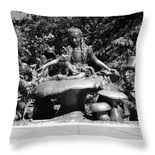 Central Park Throw Pillow featuring the photograph ALICE IN WONDERLAND in CENTRAL PARK in BLACK AND WHITE by Rob Hans