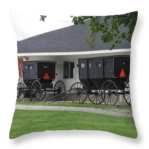 Amish Throw Pillow featuring the photograph Amish Buggies Parked by Dennis Pintoski