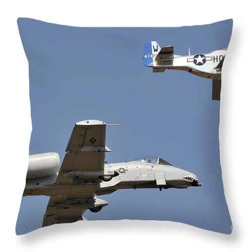 Military Throw Pillow featuring the photograph An A-10 Thunderbolt And A P-51 Mustang by Stocktrek Images