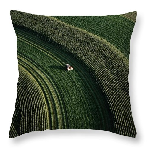 Aerial Views Throw Pillow featuring the photograph An Aerial View Of A Tractor On Curved by Paul Chesley